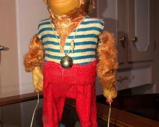 Vintage jumping monkey toy.