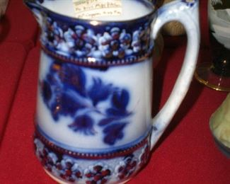 flow blue milk pitcher with gold decoration