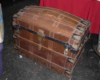 lg. oak strapped camel back trunk with brass lock