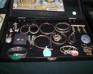 trays full of sterling jewelry