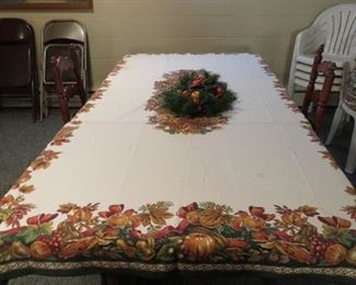 Nice gate-leg table with 2 chairs. Turns into giant family table with 4  leaves and table pads. Stores easily!