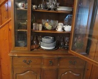 China cabinet full of goodies for entertaining.