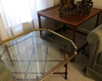 Brass rimmed glass coffee table. Beautiful wood base.