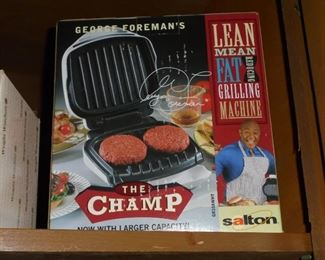 George Foreman grilling machine in box