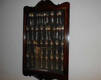 Sterling Silver spoon collection in solid wood cabinet