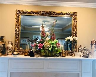 Large mirror and numerous oriental decorating items.