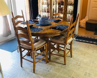 Oak pedestal dining table with 6 ladder back chairs