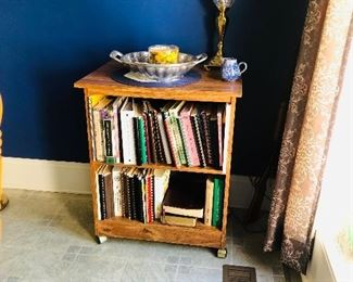Small cabinet with cookbooks