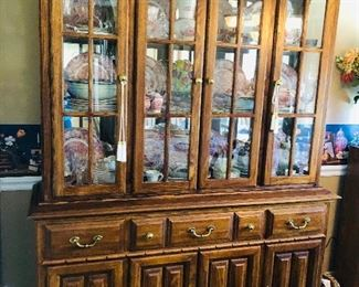 Lighted china cabinet full of pink castle Johnson bro's china.  134 pieces