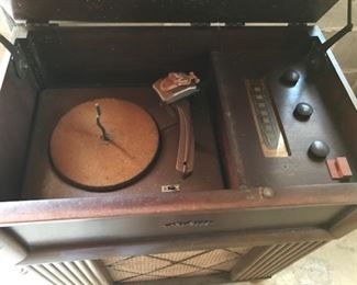 RCA stereo/record player interior.  Stylus is there but the cord is in really bad shape so we did not plug it in