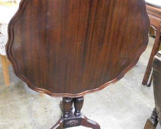 Super mahogany tilt top center table