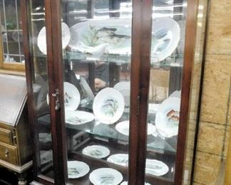Super mahogany Chippendale china cabinet has beveled glass in front panels