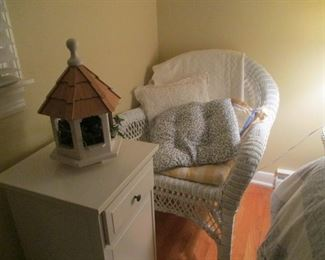 wicker pieces and small white side table
