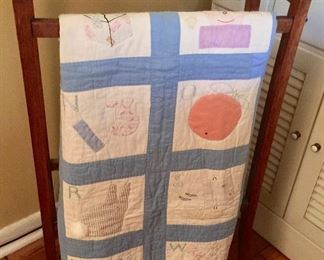Vintage quilt and rack