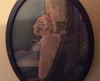 Antique small oval girl with puppy.