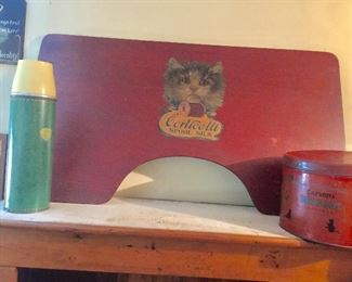 Old thermos and large cat advertising.