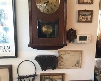Antique wall clock, vintage art and baskets