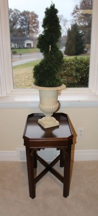 Small side table shown with urn.