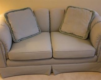 Beautifully upholstered love seat.