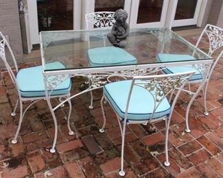 Vintage Woodard Acorn and Oak Leaf glass top table with four chairs shown with custom made Sunbrella cushions.  This set works well as a kitchenette table.