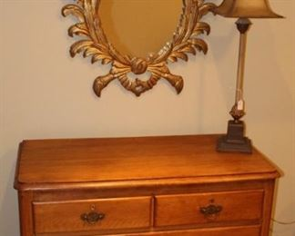 Pine chest, mirror and lamp.