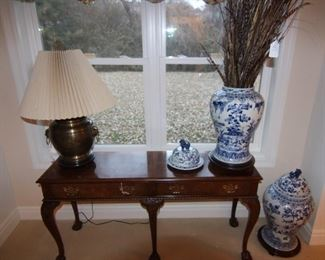 Baker console/sofa table shown with blue and white lidded ginger jars.