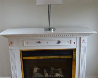 Electric fireplace and heater. Looks authentic when turned on with logs of wood and flame. It has a warm air blower and is sufficient to heat a medium size room.