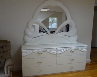 High gloss finish Italian-made dresser with 6 wide drawers.