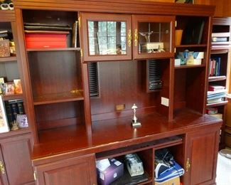 Office shelves and storage cupboards, with computer keyboard sliding pull-out.