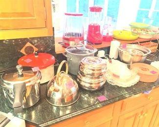 Almost new pots (includes a pressure cooker), kettle, glassware