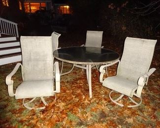 Patio round table with 4 swivel chairs.