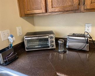 2 year old toaster oven and toaster listed with a sugar dispenser and new sink caddy.