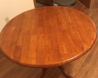 pedestal table with side drop leaves