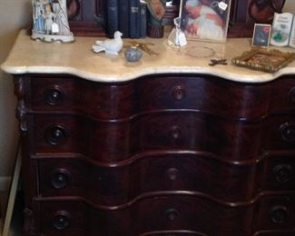 Bottom of the dresser, top was the precious picture.  Notice the bow front drawers and the marble top