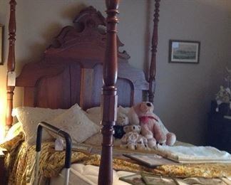 Full size tester bed.  Teddy bears,decorative pillows, framed prints