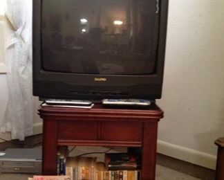 TV, nice side table (all wood),  small part of the paperback books available