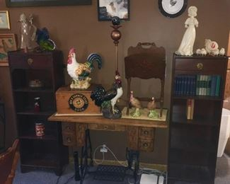 2 book/display cabinets, antique sewing machine with wood table top, Arm & Hammer soda box, magazine rack, chicken collectibles, etc