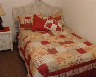 Wicker bedroom set which includes bed, nightstand, dresser and mirror