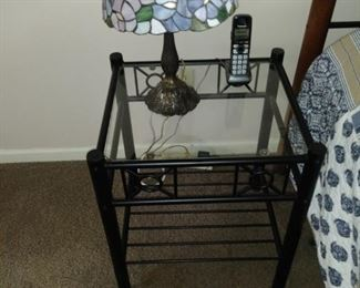 Tiffany lamp on glass top bedside table