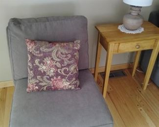 One of two casual chairs with one drawer stand