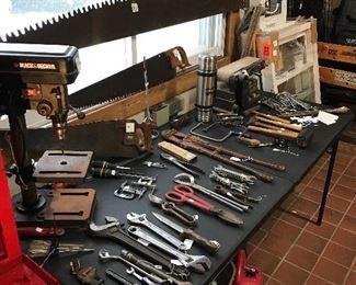 Black & Decker drill press,  Belt sander, Primitive saws and large variety of vintage hand tools