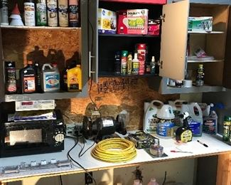 Spray paint, motor oil, chainsaw oil, microwave oven, car care products, assorted lightbulbs, yard chemicals, two Dewalt radios, vintage fan, Pool antifreeze and coolers