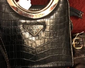 Large assortment of women's purses including  Prada, Gucci and Versace