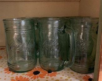 9 coke mugs. Very nice.