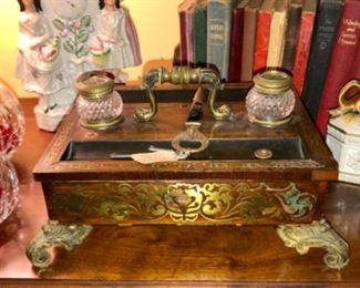 1840 French brass inlay filagree box with ink wells, pin holder, drawer for paper resting on ornate feet.