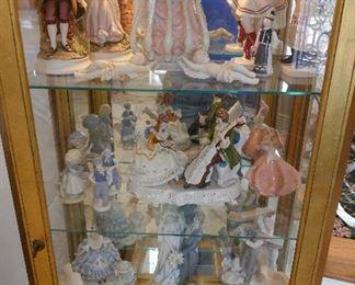 Gilt Etegere filled with Porcelain Figurines