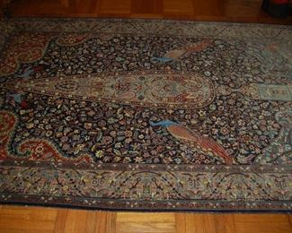 One of several antique Oriental rugs
