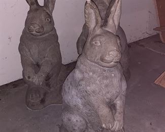 3 of 4 cement rabbits -