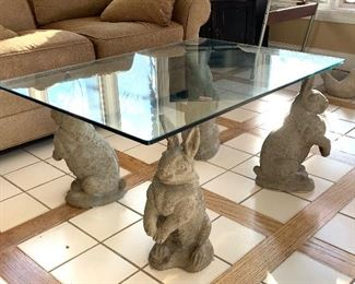 4 Cement Rabbits glass top table - love this one!  Use inside or out