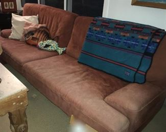"""Sofa and love seat by The Leather Center, Milano-Babuk. Love seat 67""""; sofa 88"""". Sold separately"""